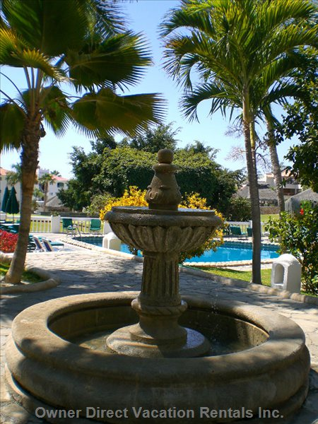 Fountain in the Courtyard - Bubbling Fountain on the Way to the Pool