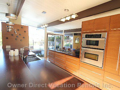 Spacious Modern Kitchen with Bamboo Counters and Cabinets