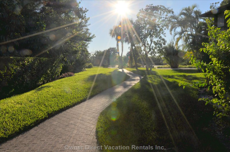 Walk to the Gulf Sanibel Beach on the Property.  (around the Rear Tennis Court on a Paver Path & Then over a Wooden Footbrdge