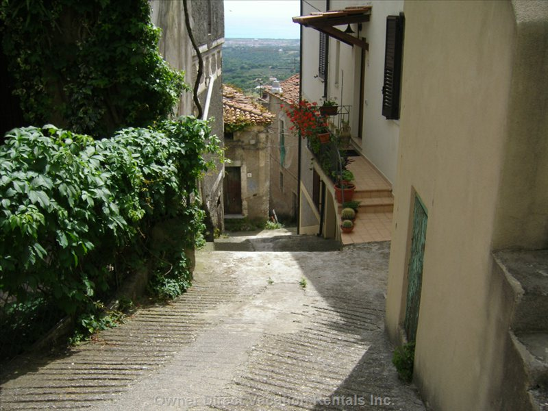 Looking down via Cosenza, our Street