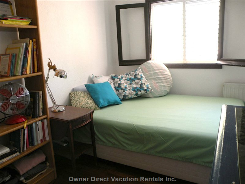 Smallest (Third) Bedroom,  Downstairs, 140x200 Mattress. Window, Bookshelves, Closet and Bureau and Fan