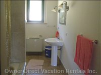 Guest Bath - Includes Two Sinks, Bathtub/Shower Unit. Bidet and Toilet.