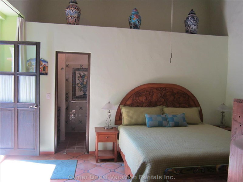 Large Comfortable King-Size Bed with Luxury Linens Decorated with Talavera Jars from Dolores Hidalgo and Hand-Painted Murals