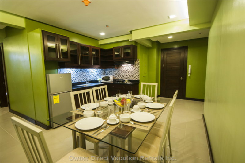 Dining Room and Kitchen - Similar to, but May Not be this Unit