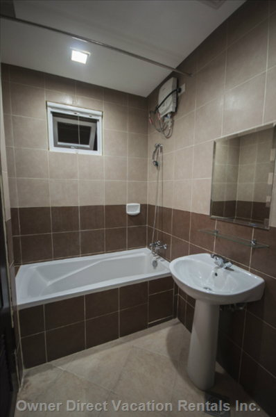 Ensuite Master's Bathroom - Similar to, but May Not be this Unit