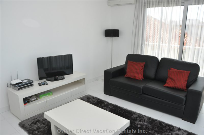 Inside of the Apartment  - Living Room with Sofa Bed and Tv /Dvd