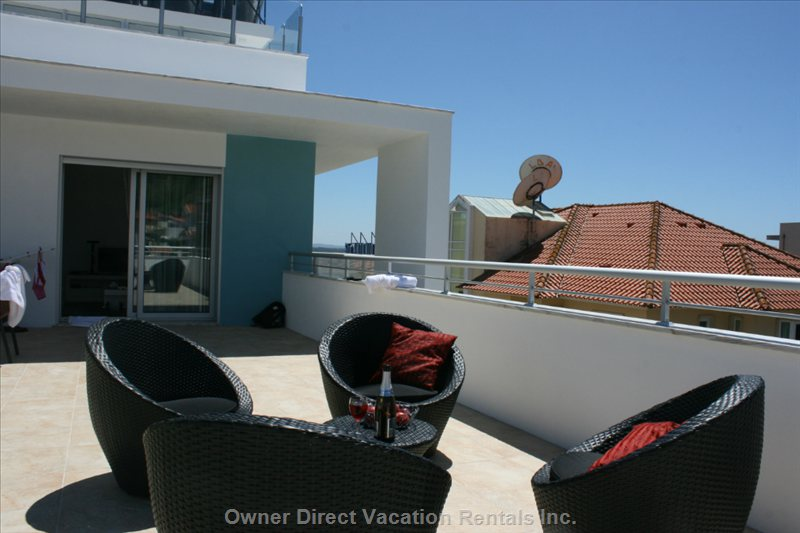 Direct Access from the Living Room to the Private, Furnished Terrace of 70 Square M.