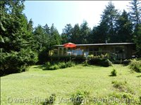 Sunny Location amid Towering Pines on a Secluded Acre.