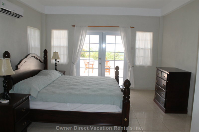 Bedrooms with Custom Mahogany Furniture Including King Size Beds