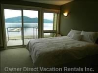 Master Bedroom - Beautiful Panoramic Views of the Lake Including Copper Island from Large Bedroom Windows