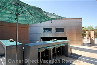 The Greatroom'S Outdoor Deck and Bar (near Main Pool) with 2 Flatscreen Tvs and a Huge Fireplace