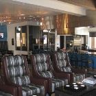 Picture #4 - Part of the Great Room in the Main Clubhouse  - a Sitting Area & Demo Kitchen. Left Background is the Gamesroom and in behind that is the Movie Theatre.