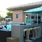 Outdoor Lounge and Bar with Firplace and 2 Flat Screen Tvs by Main Pool
