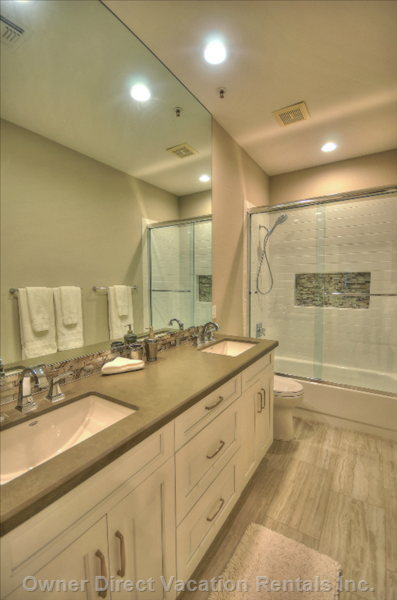 Main Bathroom Tub with Shower and Double Sinks