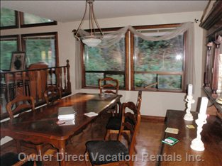 Formal Dining Room - View of River and Woods.