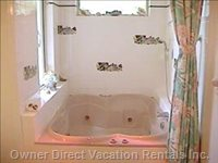 Shared Bathroom with 4 Person Hydro Massage Bathtub