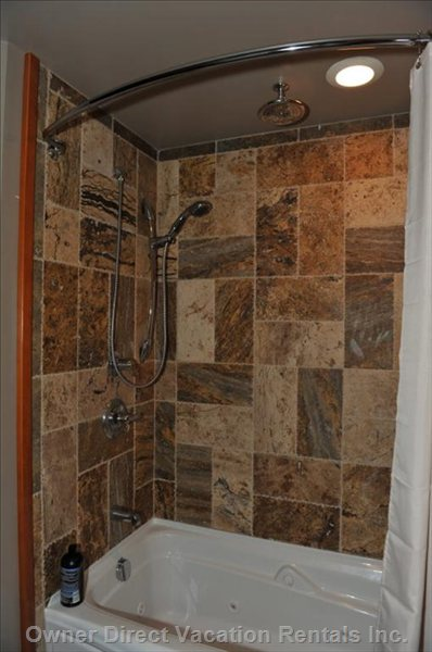 Jacuzzi Tub -  Two Shower Heads, Travertine Tile