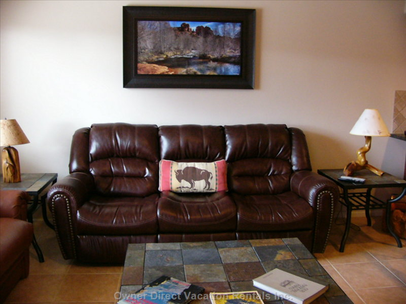 Living Room with Leather Couch that has 2 Recliners