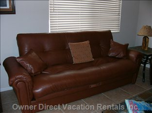 Leather Sofa Bed in Living Room - Folds down to Make Double Bed