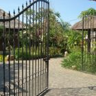 Main Gated Entrance to the Villa, Car Parking Area, Padi Fields, Grape Vines and Mountains View as you Enter.