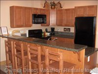 Kitchen with Eating Counter Top & all 4 Major Appliances