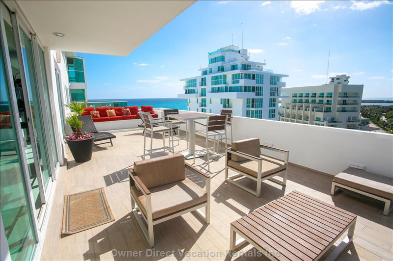 The Huge Terrace has Beautiful Caribbean Views Looking one Way, and Beautiful Bay Views Looking the Other.