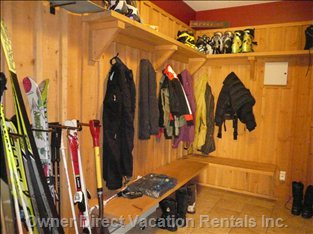 Full Size Boot Room with Lots of Hooks and Indoor Ski/Snowboard Storage.