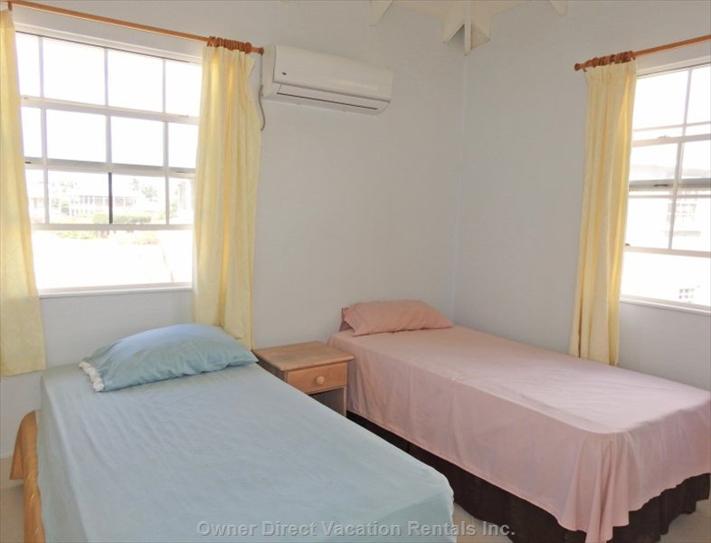 2nd Bedroom with Air Conditioning and Overhead Fan and Two Single Beds