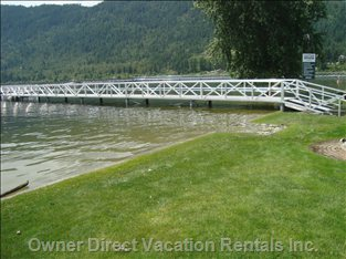White Pines Resort Located in Sicamous has a Beautiful Green Grassy Area as Well as the Softest Sand in Sicamous
