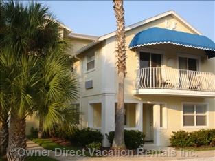 First Floor Unit with Front Patio;  Pool behind Building; Bbq Grills; Hammocks; Tropical Setting; Super Clean...And Steps to the Beach!