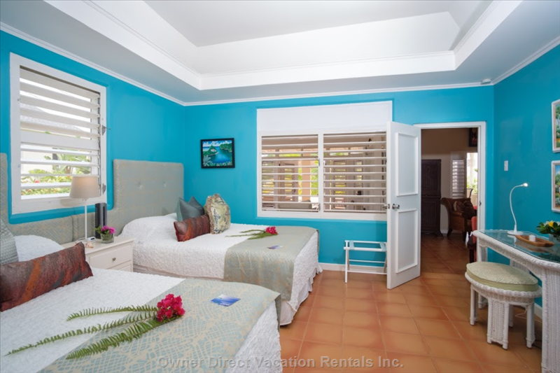 Turquoise Bed Room with 2 Queen Beds Attached Bathroom