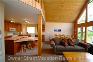 Living Room - Open Concept with Vaulted Ceilings and Fantastic View of the Ski Slope. Quad Lift Right Outside.