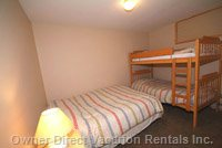Two Large Bedrooms, each with Double Bed and Twin Single Bunks. each Room Sleeps 4 - Picture of one of the Large Bedrooms.