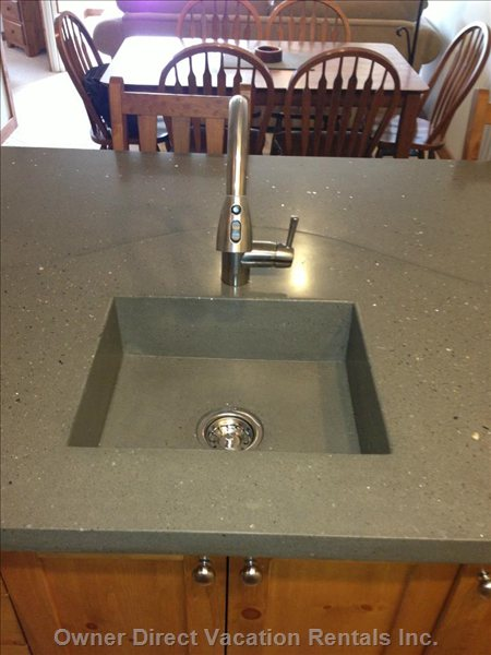 New Concrete Sinks and Countertops Top this Beautiful Renovation off!