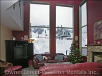 Living Room with Fireplace & Impressive Views - the Living Room Offers Amazing Views of the Mountain Trails and Chairlift.  Included Here Are; a Rock Fireplace, Plenty of Comfy Sofa Seating, Coffee &Amp; Side Tables, TV with Cable Service (DVD+Video), Wifi Internet and Also Board and Card Games.  Decorating the Walls Are Genuine Period Timber Skis from Back-in-the-day, Winter Decor Pieces and an Authentic Pendelton Series Woven Blanket.
