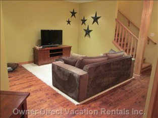 "Family Room - 42"" Flat Screen Television, DVD and Blue Ray, Pull-out Couch, Powder Room"
