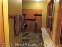 Ski Room - has a Ski Rack, Two Piece Bath, Dual Coat Closets, Covered Entry, Slate Floors and Benches