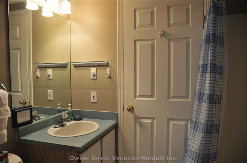Suite Bathroom with Access to Kitchen and Bedroom