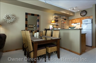 Dining Room - Upscale Solid Dark Wood Table with Glass Top, High Quality Woven Rattan and Wood Dining Room Chairs - Seats 6.