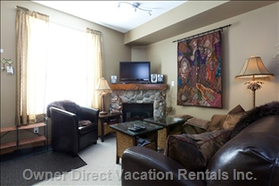 Living Room - Flat Screen Tv, Tibetan Stools, Leather Sofa Set, Hand Crafted Indian Wall Hangings, Silk Draperies, Wi-Fi and Cable.