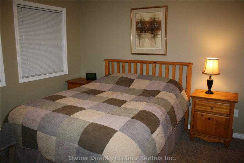 Master Bedroom - Queen Size Bed with Warm Pine Accents.