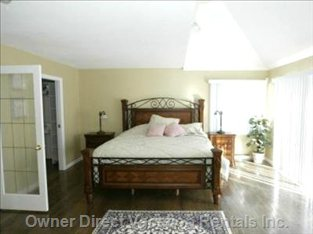 Main Bedroom with King Size Bed, Walk in Robe, Log Fireplace, Verandah, Ensuite with Jacuzzi