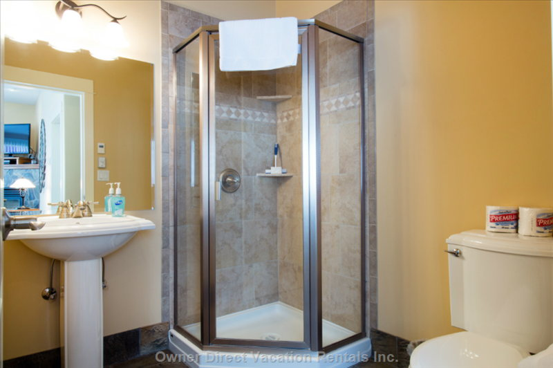 The Main Floor Bathroom has a Shower for Guests Staying in the Tv Room, and is Conveniently Located by the Ski Room for Easy Access.