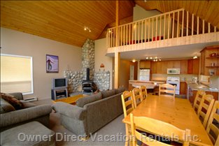 Wood Burner, Open Floor Plan, Futon, Drop down Breakfast Bar, all Updated, Ice Cold Water, Hot Tub.  - 8 Person Hot Tub Right outside the Main Floor Rear Door. Bbq and everything you Need for an Amazing Ski in out Vacation. one of the few with Wood Burner and Wood Included. External Ski Lockers.