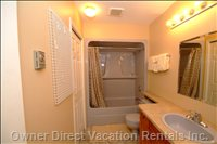 Bathroom with Tub, Shower, Bosch Washer and Dryer,