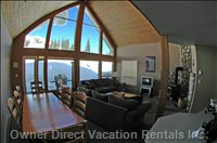 Fish Eye View of Living Room through Windows to Ski Slope and Quad Lift Right outside