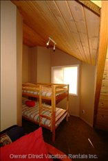 Bunkroom with Door. in the Foreground is the Mezzanine Loft with Double Futon - Note Master Bedroom Can Sleep 4 People