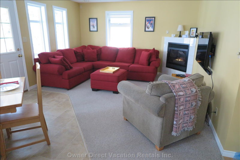 Bright, Flexible Open Living Area with Direct Access to Covered Deck Containing Hot Tub and Bbq