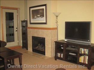 TV/Fireplace - Enjoy Cable TV, DVD'S Or Vhs on the 42&Quot; Flat Screen TV. the Apartment has a Large Selection of Movies (Vhs and DVD) for your Enjoyment. as Well, an Ipod Docking Station Allows you to Enjoy your Own Music.