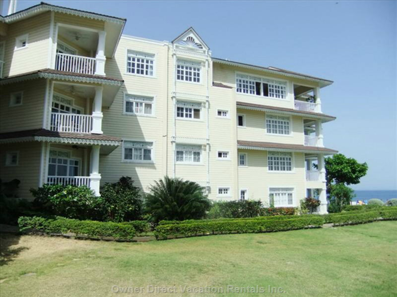 Condo within a Complex that Overlooks the Ocean and Beach from a Bluff.